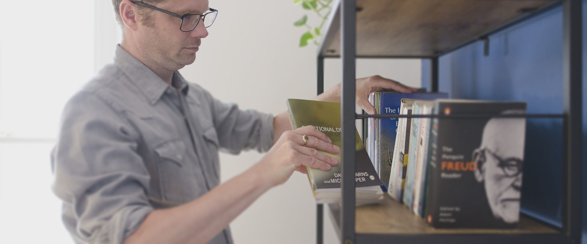 David Wigglesworth organising books on shelf